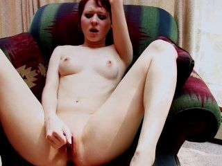 This Hot Redhead Is Using Two Vibrators