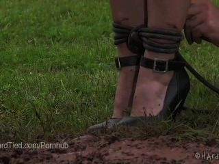 Elise Graves Gets Dirty In Outdoor Bondage In The Mud