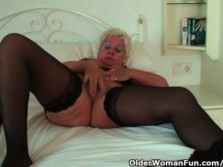 Chubby Granny With Big Tits Wears Black Stockings And Masturbates