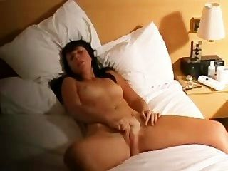 Brunette Orgasms With Her Fingers