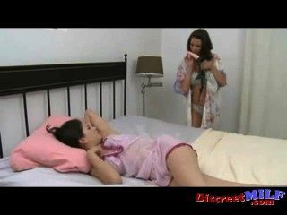 Mom fucks her sexy daughter with a strapon