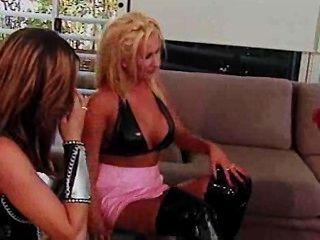 Lesbians Spank Each Other In Latex