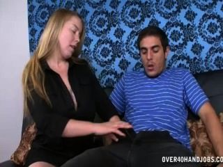 Slutty Milf Jerking A Young Guy