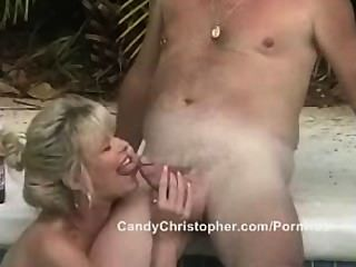 Mature Sucks Cock By The Pool