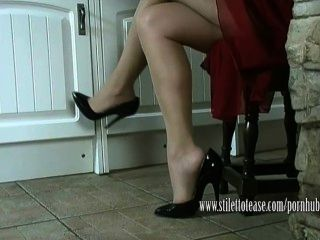 Hot housewife dangles her stilettos and teases her sheer nylon legs