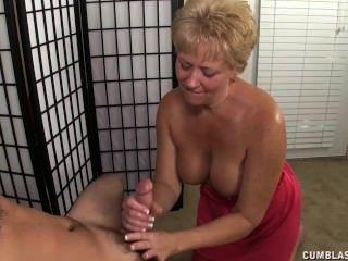 Busty milf gets splattered with cum