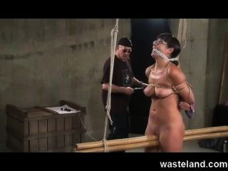Wasteland Dungeon Master Ties Up Submissive Brunette And Uses Sex Toys
