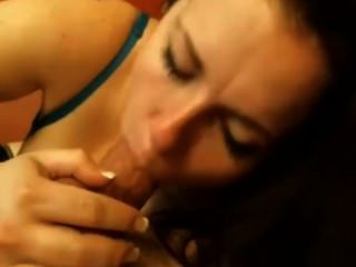 Brunette Sucking A Cock