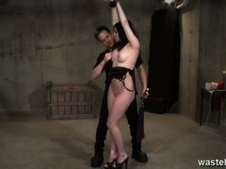 Sexy Long Haired Sub Girl Hanging From Ceiling Gets Whiped