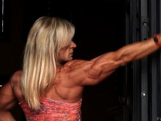 Muscle Milf Kris Flexes Her Erotic, Veiny Body In Tight Clothes