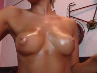 Hot Girl Oiling Her Tits And Fooling Around