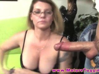Busty With Glasses Gives Cock Rub