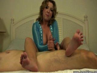 Aunt Jacki Handjob In Bed