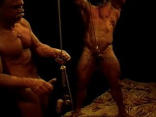 Pounding hunk balls with fist and mallet