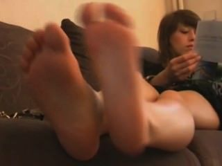 Brunette Girl Shows Her Cute Feet On The Couch