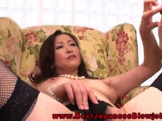 Hot Oriental Milf Puts Vibrating Toy In Her Moist Pussy