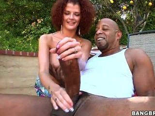 Curly redhead Joslyn James takes massive black snake