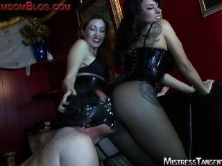 Two Femdom Mistresses Foot Domination Face Sitting And Humiliation Of Male