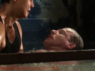 Body Builder Faces The Water Chamber