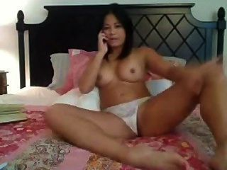 Asian Babe On The Phone Fingering And Dildoing