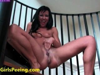 Hot Girl Pisses On The Stairs!